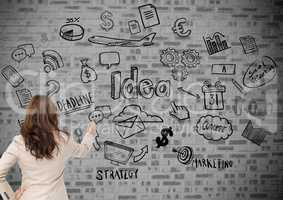 Businesswoman touching communication and currency icons against wall background