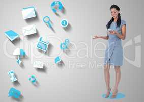 Happy woman holding mobile phone and various application icons in background