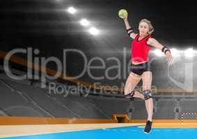 Female athlete playing handball in stadium