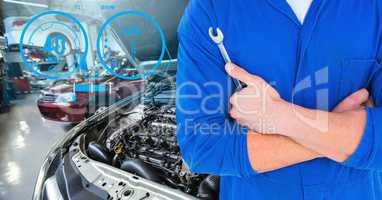 Mechanic holding lug wrench in car repair garage