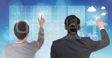 Rear view of businesspeople touching digital screen