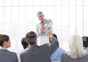 Businessman giving a speech in conference hall