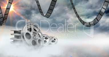 Film reels against sky in background