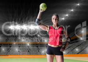 Female handball player holding ball at handball court