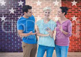 Executives discussing over digital tablet against brick wall with star shapes