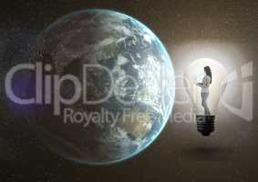 Digital composite image of a girl using laptop in the electric bulb