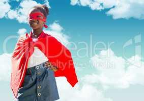 Superhero kidSmiling girl wearing superhero costume standing with hands on hip