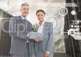 Digitally generated image of businessman and woman using digital tablet