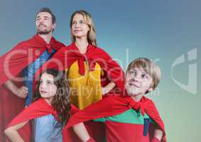 Super family wearing red cape standing with hand on hip against clear sky background