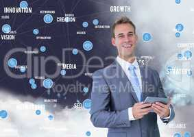 Businessman holding digital tablet with connecting icons