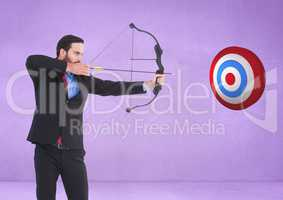 Successful businessman aiming target with bow and arrow against purple background