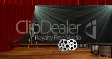 Camera with film reels on stage with red drape curtains