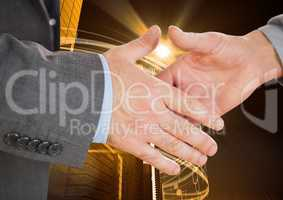 Close-up of businessman and woman shaking hands