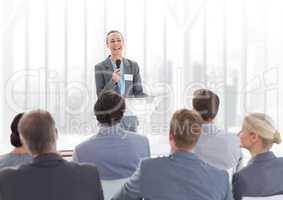 Businesswoman giving a speech in conference hall