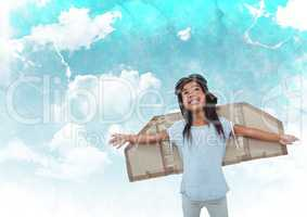Smiling girl pretending to be a pilot against cloudy sky background
