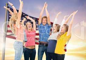 Group of people cheering against American flag