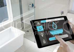 Conceptual image of a man adjusting temperature by using digital tablet