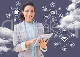Portrait of a businesswoman using digital tablet with clouds and applications icons in background