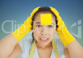 Stressed woman in rubber gloves with blank sticky note on her forehead