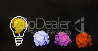 Conceptual image of bulb with multi colored crumpled paper