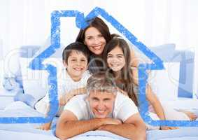 Family on bed together with house outline