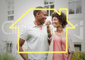 Conceptual image of couple holding keys for their new home