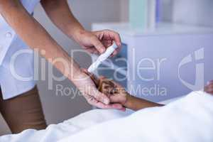 Female doctor checking patient sugar level