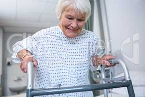 Smiling senior patient holding walking frame