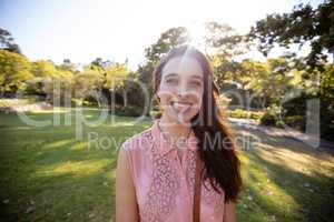 Portrait of beautiful woman smiling in the park