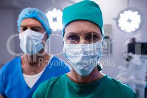Surgeons wearing surgical mask in operation theater