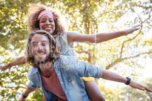 Man giving a piggyback ride to woman