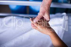 Doctor checking girls hand in the hospital