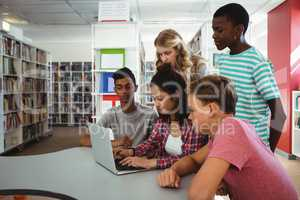 Group of students using laptop