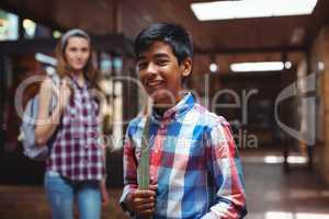Portrait of classmate standing in corridor