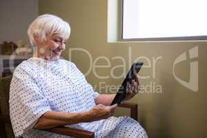Senior patient using digital tablet to video chat