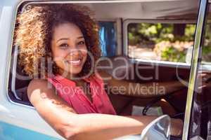 Woman driving a campervan