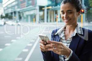 Business executive using mobile phone