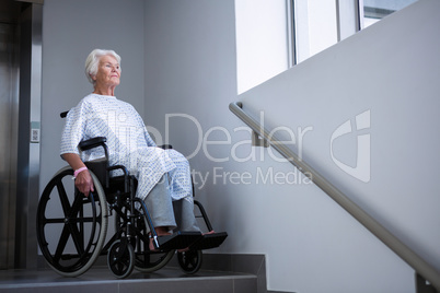 Disabled senior patient on wheelchair near staircase