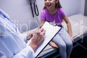 Girl consulting a doctor