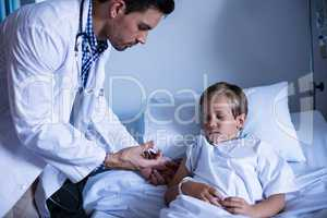 Male doctor injecting patient