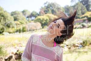 Woman swaying her hair in park