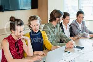 Business team interacting with each other in conference room