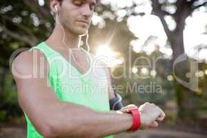 Man checking time while jogging