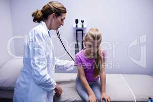 Doctor examining a patient with stethoscope