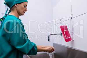 Female surgeon washing her hands