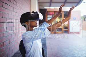 Schoolgirl using virtual reality headset