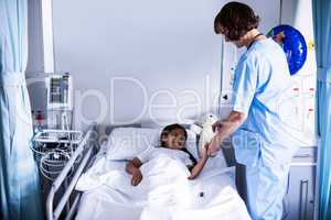Female doctor checking a sugar level of patient