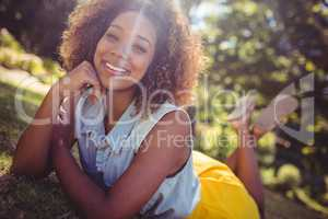 Smiling woman lying on a grass