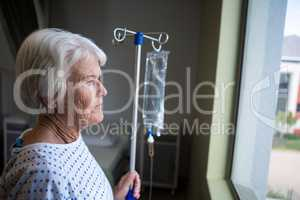 Senior patient standing at hospital