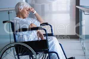 Disabled senior patient on wheelchair in hospital passageway